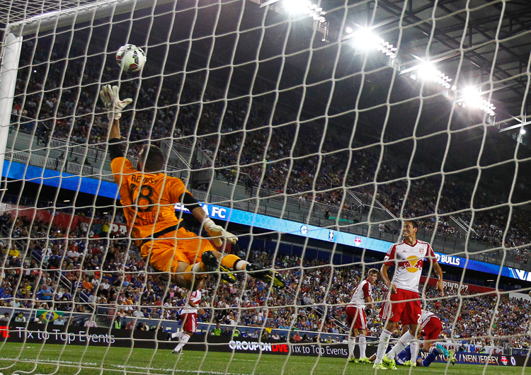 New York Red Bulls goalkeeper Kyle Reynish (18) leaps into the air to make a save against Chelsea during the International Champions Cup at Red Bull Arena. Red Bulls defeated Chelsea 4-2.  Harrison, NJ  7/22/15  (Photo Credit: Saed Hindash)