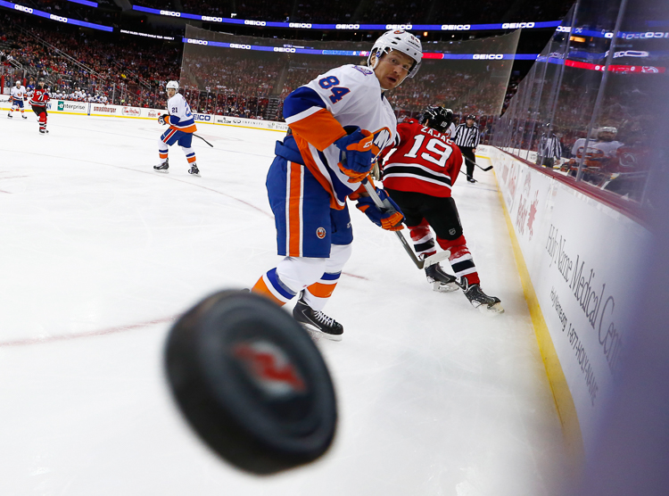 New York Islanders center Mikhail Grabovski (84) eyes the puck as it flies around the boards against the New Jersey Devils during the first period at the Prudential Center.  Newark, NJ.  1/9/15  (Photo Credit: Saed Hindash)
