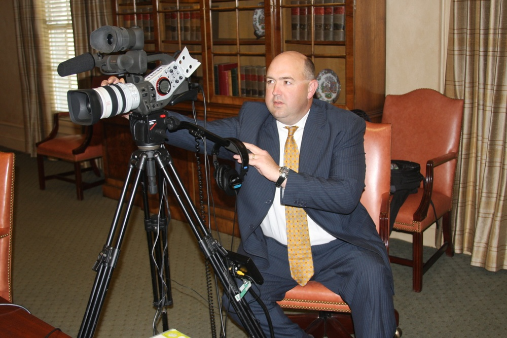 Legal Videographer preparing for a video deposition.