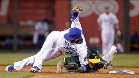 Oakland A's 3B Brett Lawrie (Langley, BC) slid hard into Kansas City Royals SS Alcides Escobar on Friday. It wasn't any more aggresive than the way Royals greats George Brett or Hal McRae used to break up double plays. The Royals took exception and Lawrie was plunked Saturday. Photo: Charlie Riedel.