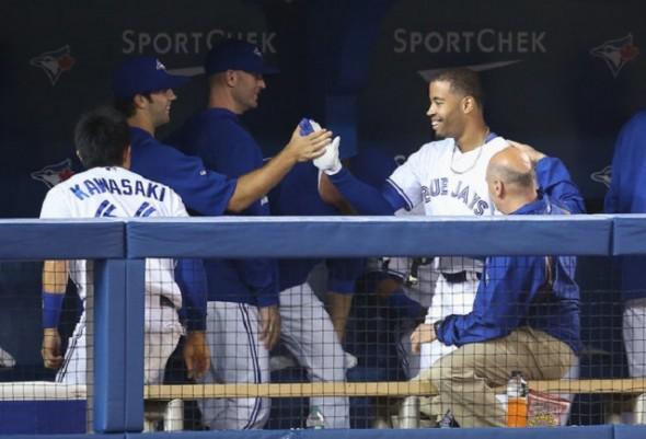 Dalton Pompey, Oakville Royals grad, is congratulated in the dugout after hitting his first homer … and he he hit off former Cy Young award winner Felix Hernandez of the Seattle Mariners.