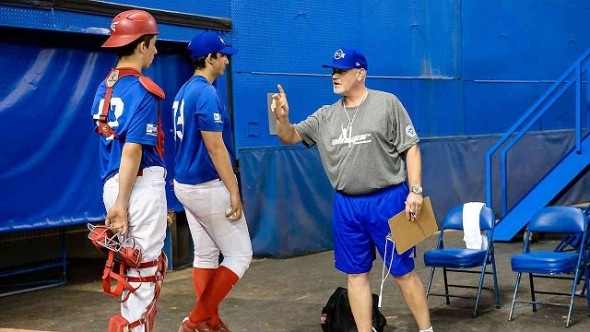 Former Blue Jays closer Duane Ward gives some instructions to a pair readying to leave the Rogers Centre bullpen at tryouts for the third annual Tournament 12 which features the best high schoolers from across Canada. Photo: Michele Prata.