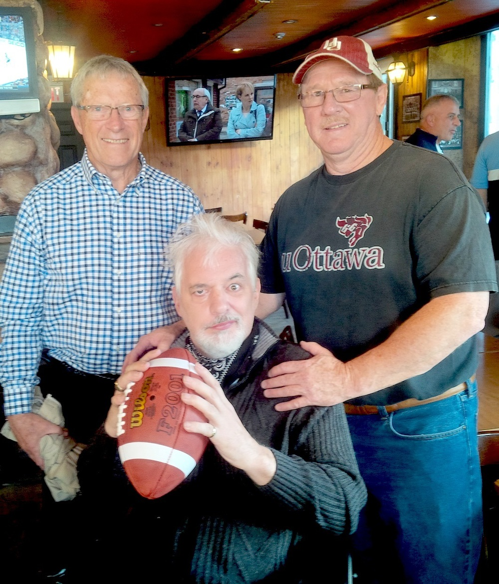 * Yves Leclerc, middle, saved the day for the University of Ottawa Gee-Gees in the 1975 Vanier Cup to save an undefeated season. Now, Leclerc flanked by receivers coach Bob Swann and wide receiver Duncan Armstrong, faces an uphill battle ... and his former teammates have his back. ....