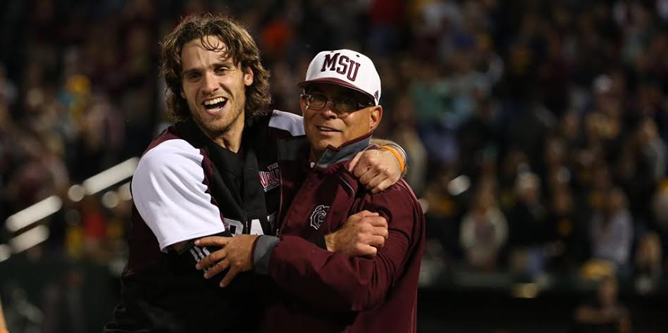 SS Joey Hawkins (Whitby, Ont.) hugs coach Keith Guttin after the Missouri State Bears won the Springfield, Mo. NCAA regional to advance to the super regional against Arkansas.