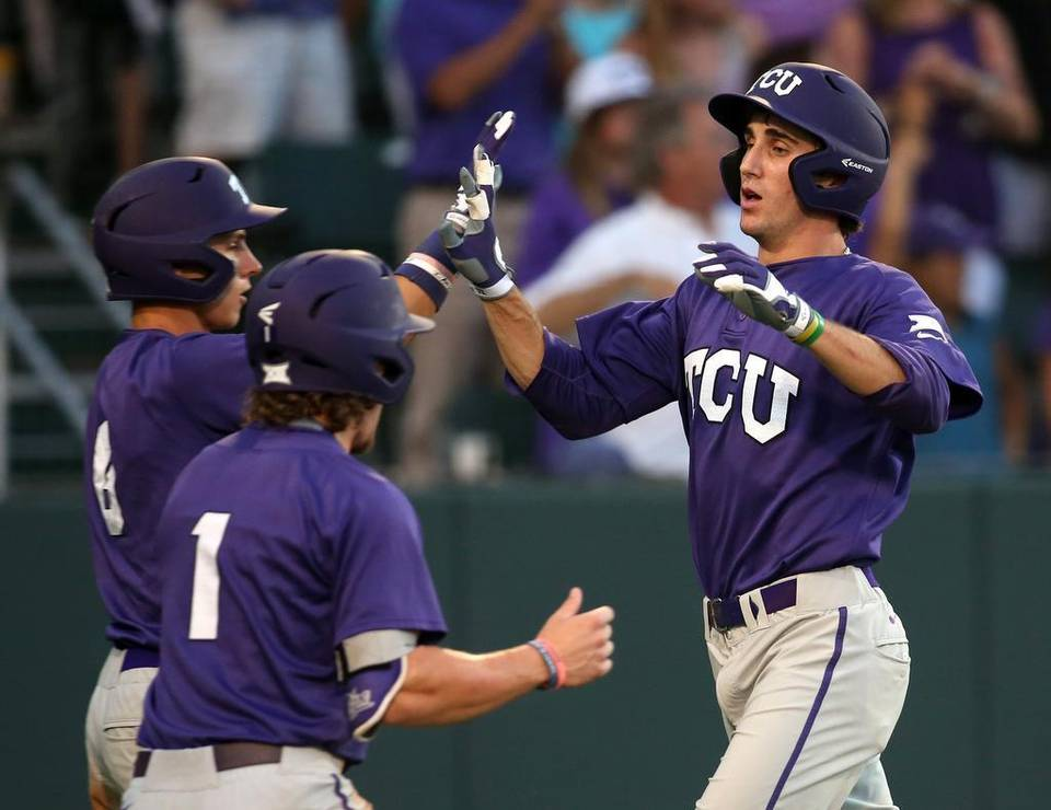 TCU's Nolan Brown (6) and Cody Jones (1) celebrate with Jeremie Fagnan (32). Photo Richard W. Rodriguez.