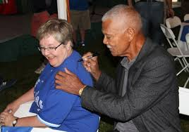 Former Montreal Expos manager Felipe Alou signing autographs after being inducted into the Canadian Baseball Hall of Fame in St. Marys.