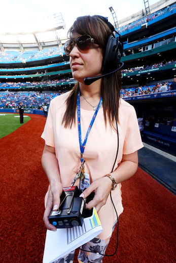 Holly Purdon Gentemann, who has 101 responsiliities with the Blue Jays, runs pre-game on-field ceremonies at the Rogers Centre.