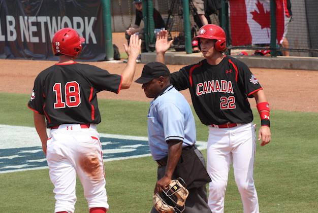 Kellin Deglan, 22 (Langley, BC) congratulates Brock Kjeldgaard (London, Ont.) as Team Canada beat Team USA collegians 12-2 in Cary, NC. Photo: Baseball Canada.