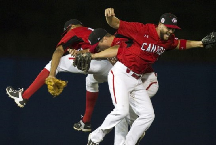 Canada's outfield of CF Tyson Gillies, LF Tyler O'Neill and RF Rene Tosoni celebrate after a win over the Dominican Republic. Photo: Fred Thornhill.