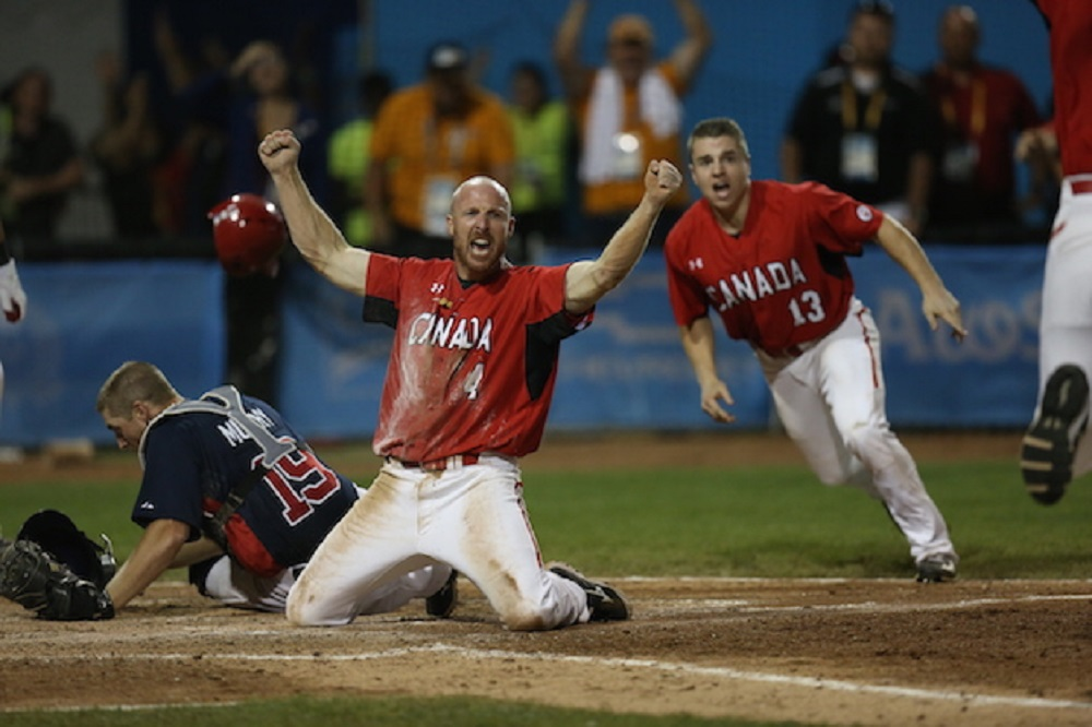3B Peter Orr arrives safe at home, scoring all the way from first base after two throwing errors and beating a subsequent throw home as Canada won gold in the Pan Am Games Sunday night in Ajax.
