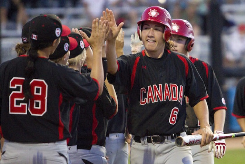 Stéphanie Savoie (La Pocatiére, Que.) No. 6 gets high-fives as Canada won its opener in the Pan Am Games 13-1 over Cuba.