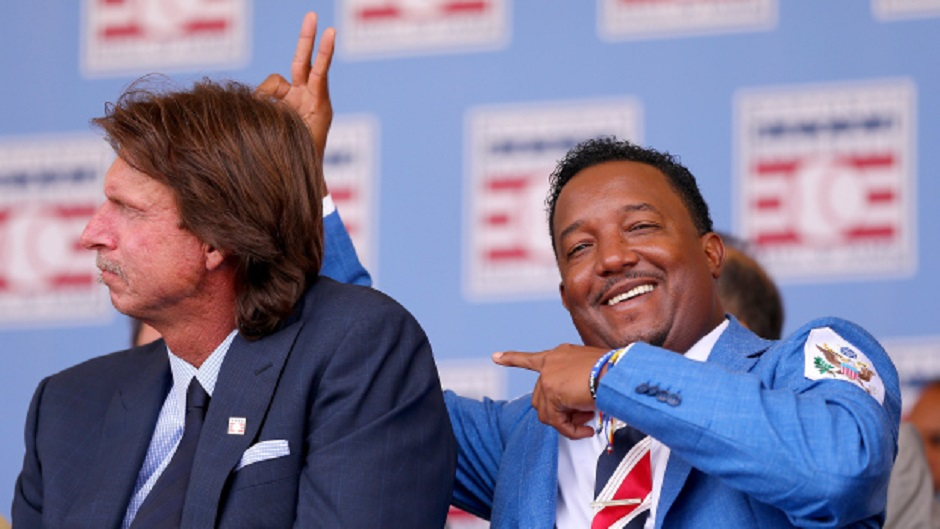 LHP Randy Johnson, left, and Pedro Martinez, hamming it up on induction day, spent the early part of their Hall of Fame careers with the Montreal Expos.
