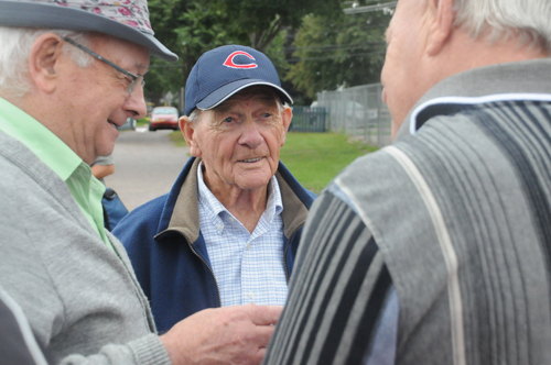 Hank Landry (centre) with former teammates Gerald Keough and George Dalton after the ceremony officially naming Legends Field in Summerside, PEI, in honour of Landry and other baseball stars. Photo: Brett Poirier/Journal Pioneer.