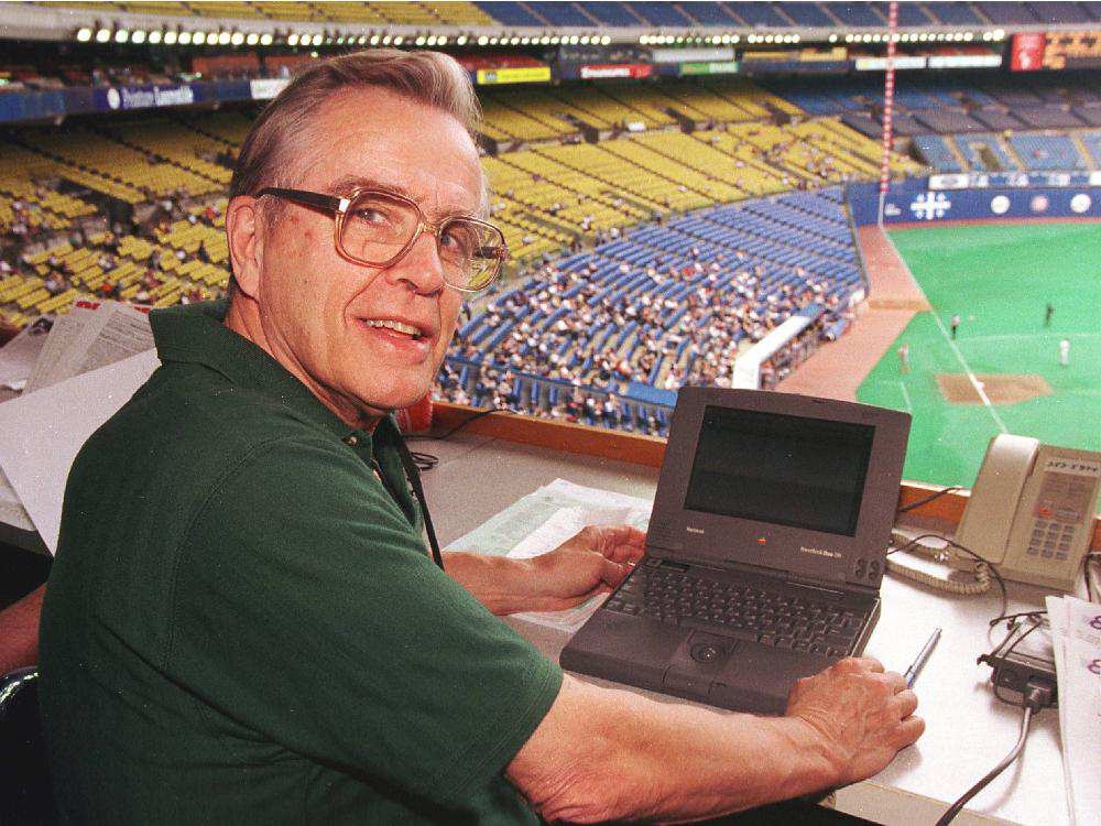 Former Montreal Gazette sportswriter Ian MacDonald as his regular seat in the Olympic Stadium press box. Photo: Andre Pichette/Montreal Gazette.