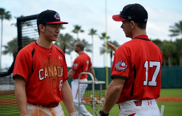 2B Royce Ando (Mississauga, Ont.) talks with Canada`s U18 coach Greg Hamilton.