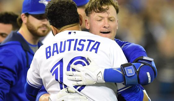 Josh Donaldson (right) hugs Jose Bautista after another Blue Jays win.