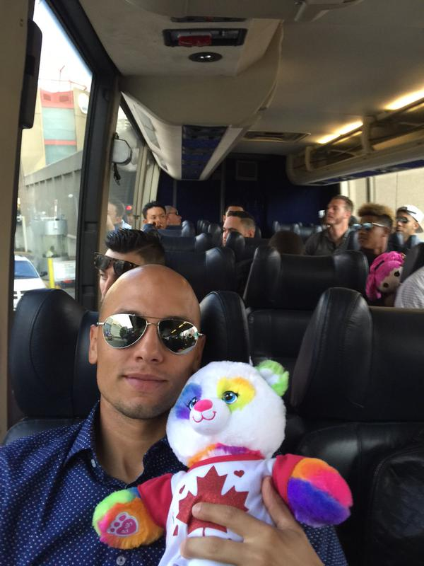 2B Ryan Goins and his bear buddy on the Blue Jays bus.