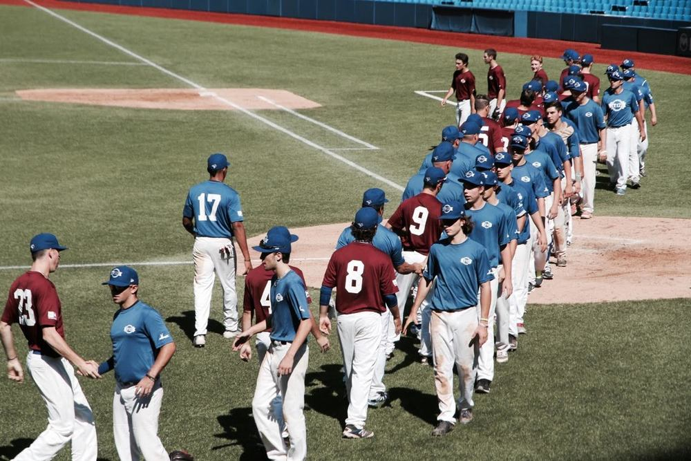 Atlantic Maroon and Quebec Blue shake hands after their game. Photo: Tyler King.