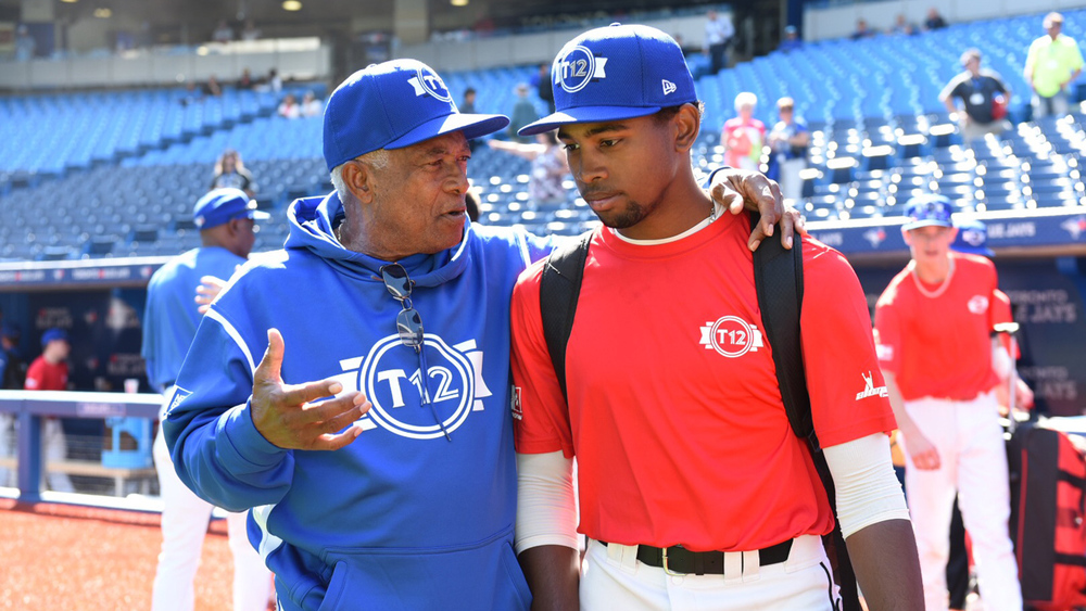 Sandy Alomar explains the finer points to Kobe Hyland (Calgary, Alta.) Photo: Michele Prata.