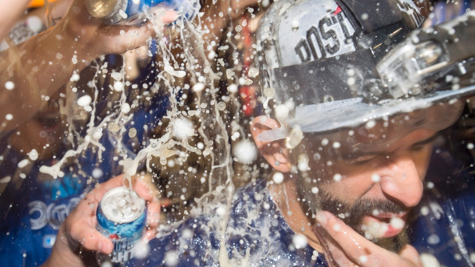 Two-homer man Jose Bautista is somewhere in there behind all the suds.