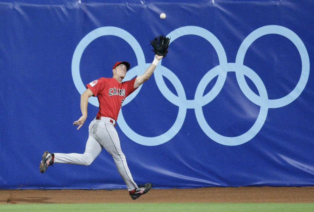 OF Michael Saunders (Victoria, BC) makes a fine running catch on the track during the 2008 Athens Olympics.