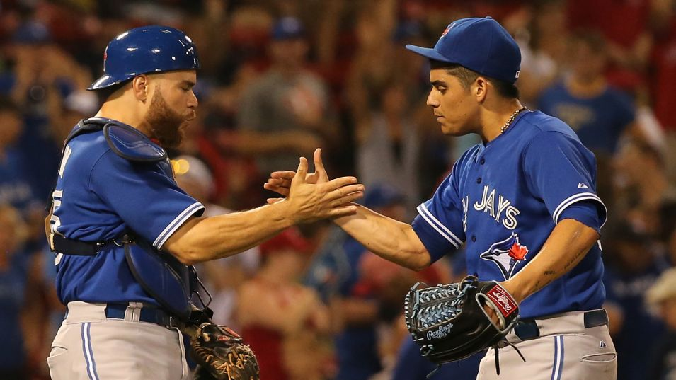RP Roberto Osuna (right) shakes hands with C Russell Martin (Montreal, Que.) after a save. Photo: Getty Images.