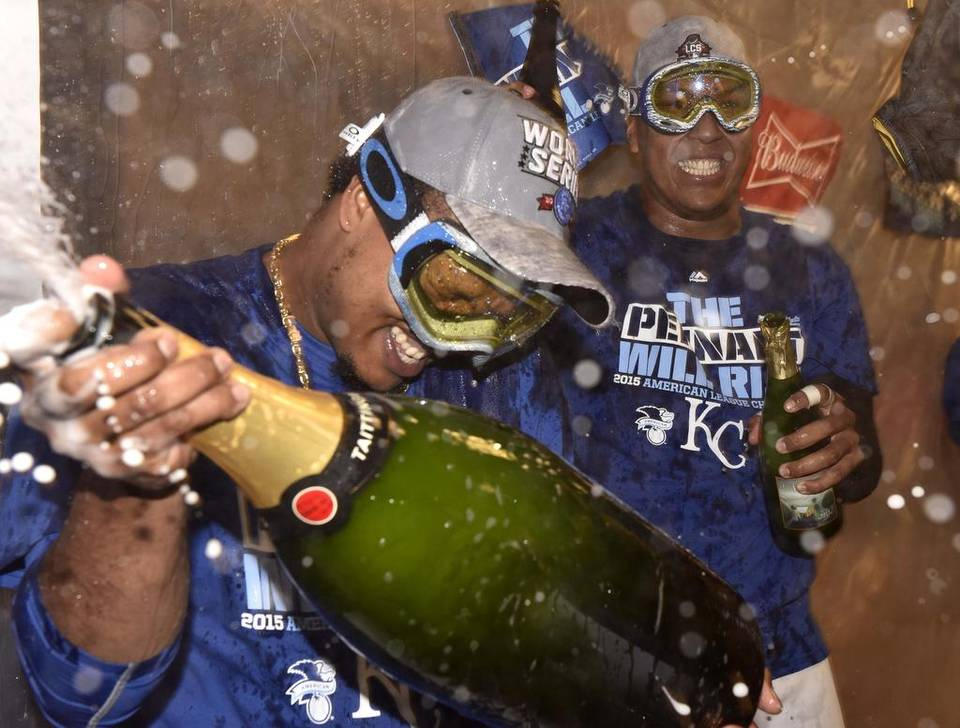 Kansas City Royals' Edinson Volquez and Salvador Perez celebrate in the locker room after 4-3 win over the Toronto Blue Jays to advance to the World Series.