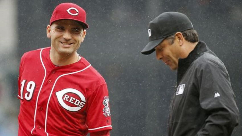 Cincinnati Reds 1B Joey Votto (Etobicoke, Ont.) a former Etobicoke Ranger talks with umpire James Hoye.