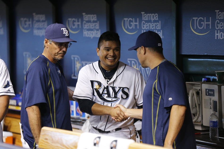 RHP Erasmo Ramirez (middle) shakes hands with Tampa Bay Rays manager Kevin Cash after pitching 7 2/3 scoreless (one single) against the New York Yankees in September. Photo: George Pappas.