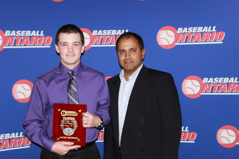 Jacob Brennan of the Barrie Red Sox is presented is OBA player of the year award by director Dirk Drieberg.