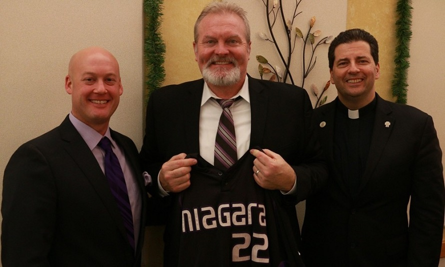 New Blue Jays advisor, manager-in-waiting Erie Wedge, centre, was the guest speaker at the Niagara University First Pitch diner in Niagara Falls, N.Y. He is flanked by coach Rob McCoy and Rev. James J. Maher, C.M., president of Niagara University.