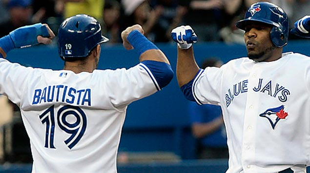 Jose Bautista (19) greets Edwin Encarnacion after another long bomb. Both are entering the final years of their contracts.