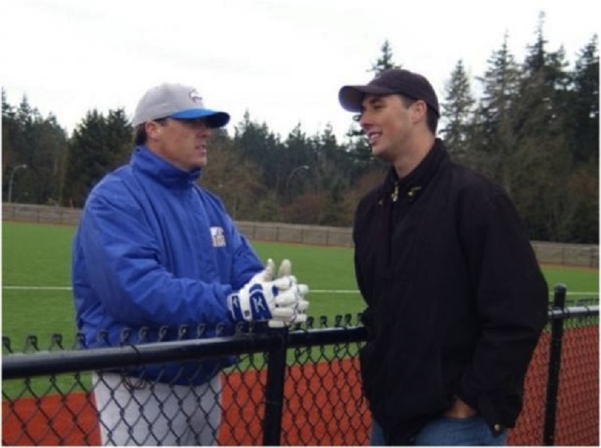 Former University of British Columbia Thunderbirds coach Terry McKaig chats with alumni Jeff Francis. Photo: Robert Broughton.