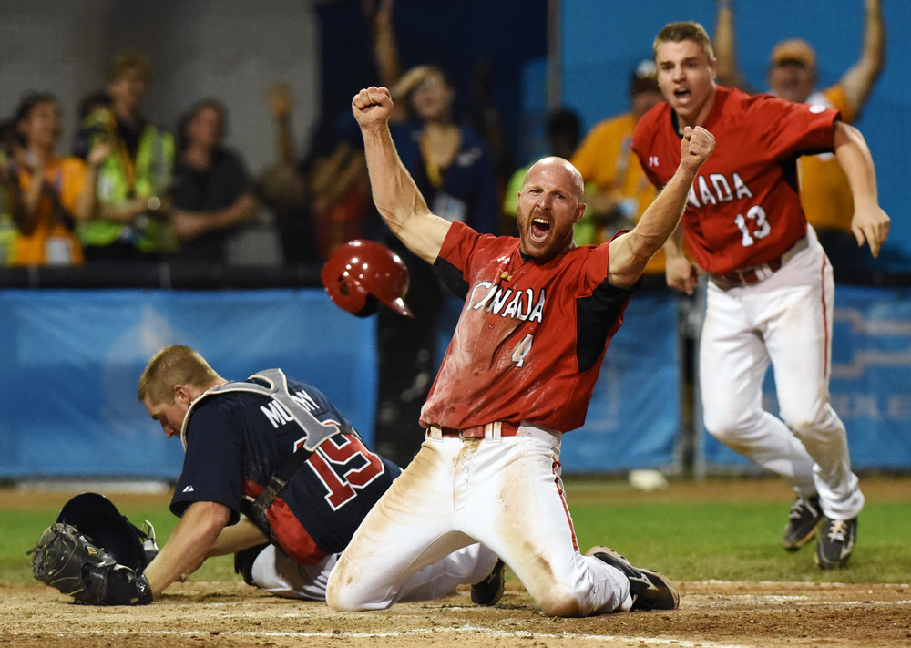 And with the head first slide Peter Orr is safe and Canada wins gold with one out in the bottom of the 10th at the Pan Am Games in Ajax. Photo: Ryan Pfeiffer/Metroland.