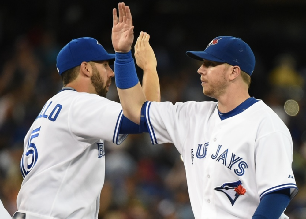 CHRIS COLABELLO, LEFT, AND JUSTIN SMOAK ARE BOTH VYING FOR PLAYING TIME AT FIRST BASE WITH THE BLUE JAYS.