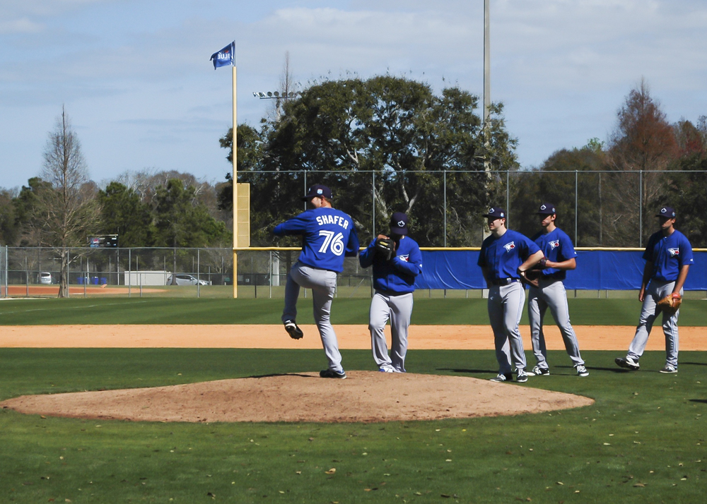 Justin Shafer begins his windup during Toronto Blue Jays spring training in Dunedin, Florida. Photo: Wes Stevenson