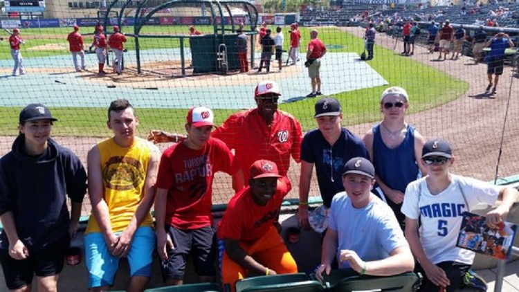 Washington Nationals manager Dusty Baker takes time out during batting practice to say hello to the Etobicoke Rangers 15U. before the Florida Marlins hosted the Nats in Jupiter, Fla.
