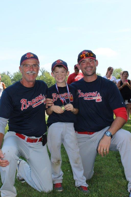 "The Smith family -- (left to right)   Don Smith, 59, Duncan  Smith, seven and Scott Smith, 36, former Laurier Golden Hawk stud --  of the   Sarnia Braves Minor Rookie  in a picture entitled ""3 generations. What a summer!"""