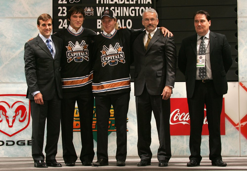 Ross Mahoney, second from right, poses with former Caps' GM George McPhee, Alex Ovechkin, Niklas Backstrom and Mats Weiderstal.