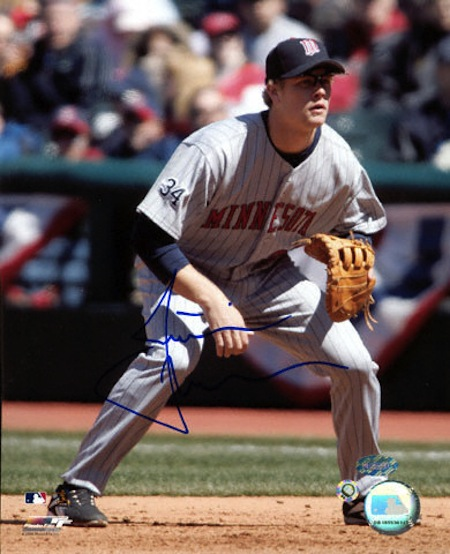 justin-morneau minnesota-twins-fielding-autographed-photograph-3362507