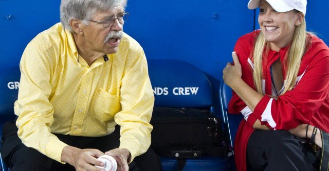 Bob Elliott anxiously awaits first-pitch ceremonies while talking to Alexis Brudnicki at the Rogers Centre in 2012.