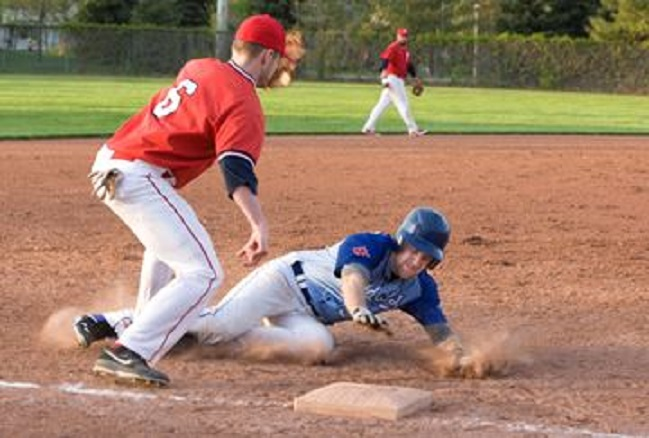 Erindale 3B Pip Murray-Smith (in Red) tries to apply the tag to Brampton OF Andrew Thomson on a close play at third. Thomson was the COBA Player of the Week while Murray-Smith was given honorable mention.