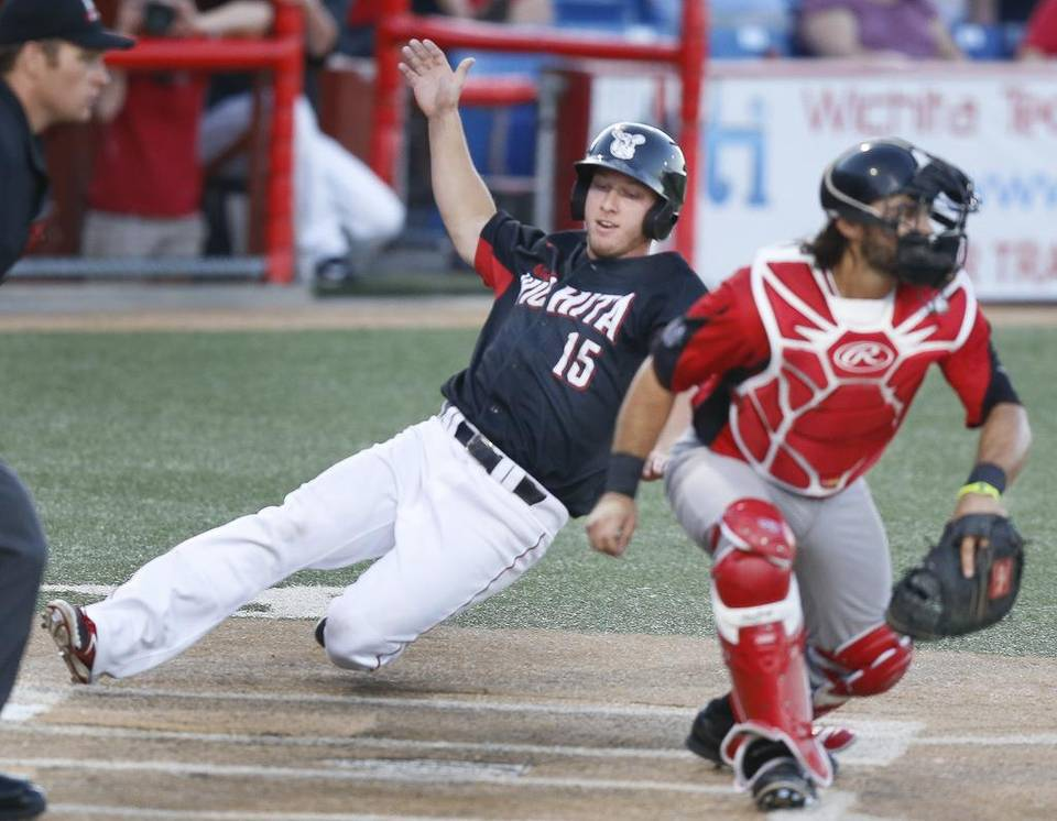 Grand Prairie C Zane Chavez takes the throw -- too late to tag Wichita Wingnuts' T.J. Mittlestaedt. Photo: The Wichita Eagle.