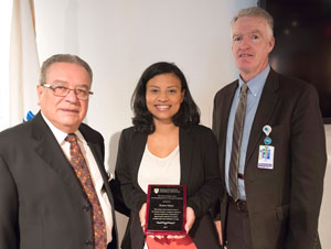 Health worker Karen L. Mejia received an annual award named in honor of Dr. Gonzalez-Martinez for her service to the Latino community in 2015. With her are Dr. Gonzalez-Martinez (left) and Jeff Davis, senior vice president of Human Resources.