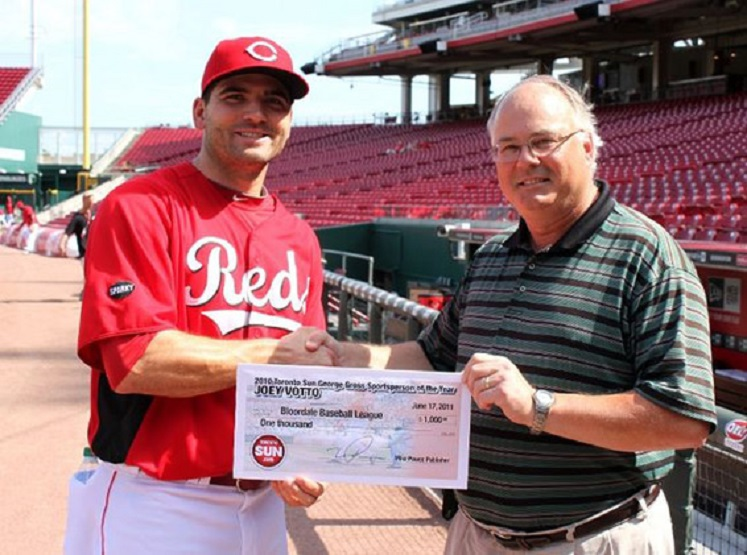 Joey Votto accepts the George Gross award and a check -- which he donated to the Bloordale Little League -- from former Toronto Sun scribe Ken Fidlin.