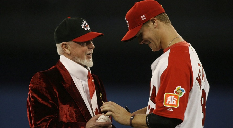Justin Morneau (New Westminster, BC), right receives some hitting tips from from Donald S. Cherry (Kingston, Ont.) before the 2009 World Baseball Classic at the Rogers Centre.