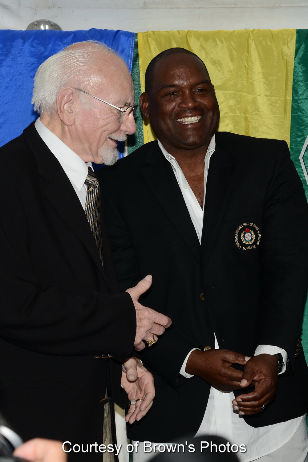 Former Montreal Expos managerr Jim Fanning extends congratulations to Tim Raines on his induction fo the Canadian Baseball HOF in St. Marys.