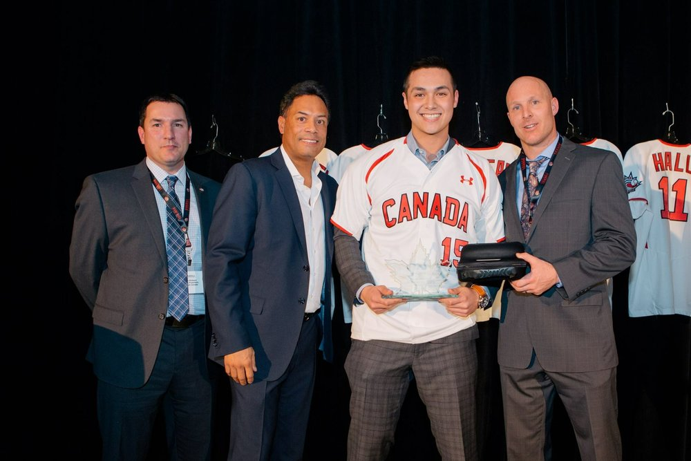C Andrew Yerzy flanked by Baseball Canada president Jason Dickson (Chatham, NB), Hall of Famer Robbie Alomar and Peter Orr (Newmarket, Ont.). Yerzy played for the Toronto Mets.