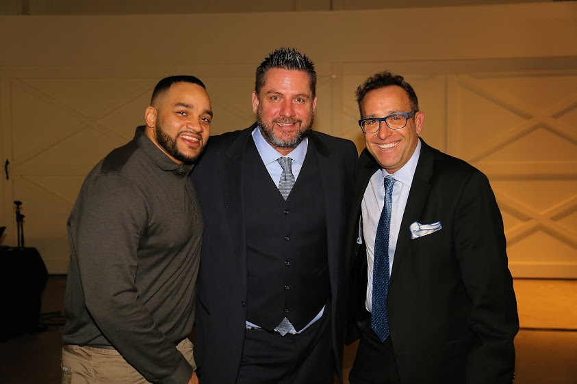 Edmonton Eskimos running back Calvin McCarty, Prospects volunteer Shawn Green and Rick Bronson MC at the first Fund raising Gala for the Edmonton WMBL team.