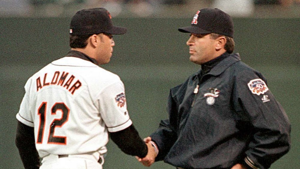 Robbie Alomar, not yet a Hall of Famer, left, apologizes to umpire John Hirschbeck. The two became good friends and Hirschbeck supported Alomar as a HOF candidate. Hirshbeck retired this week after 33 years.